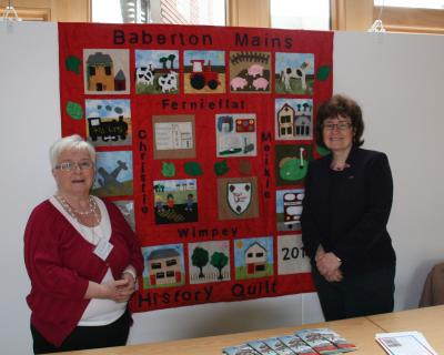 Sarah Boyack and Muriel Adam (left) with quilt
