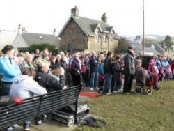 Crowds at the unveiling of the Juniper Green monument